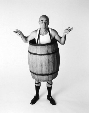 Confused man in barrel photo