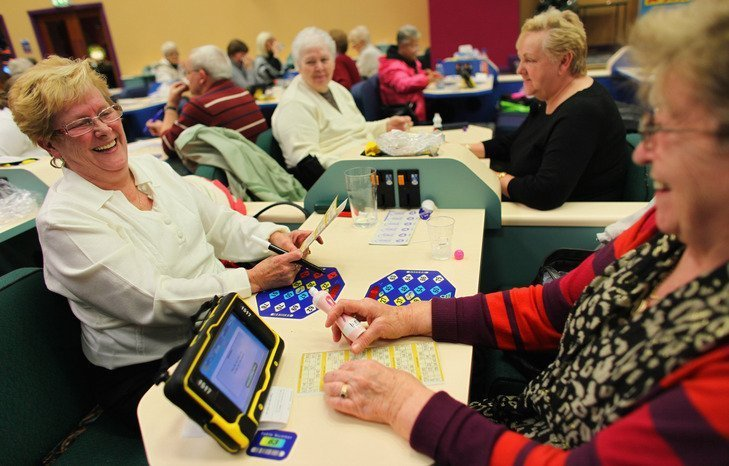 GLASGOW, SCOTLAND - DECEMBER 14: Bingo enthusiasts attend the afternoon session at the Carlton Bingo Hall on December 14, 2009 in Glasgow, Scotland. Bingo halls across the UK have been growing in popularity despite the recent smoking ban and global recession. Industry analysts estimate that one and a half million people play the game each week. The industry received a boost from Alistair Darling in his recent pre budget report when he cut the tax on bingo from 22% to 20% after enthusiasts waged a campaign against the tax increase. (Photo by Jeff J Mitchell/Getty Images)